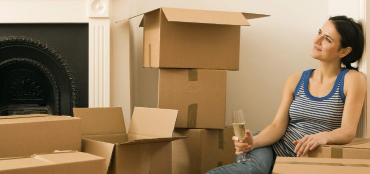 Woman drinking champagne after a smooth moving process.