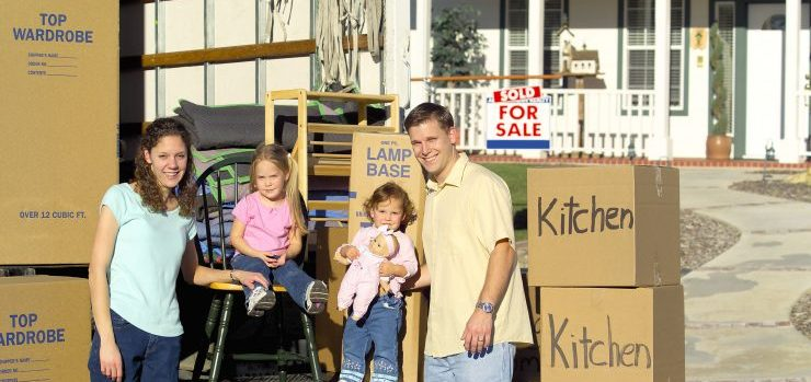 Happy family on moving day