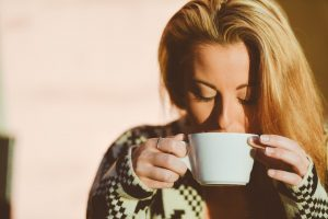 A woman drinking coffee, getting ready for a successful moving day.