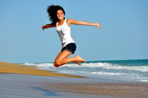 a woman jumping and smiling