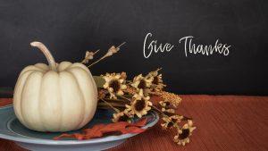 Give thanks written next to a pumpkin decoration.