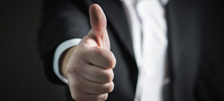 Man showing a thumbs up gesture.