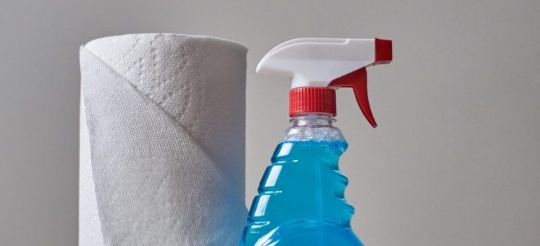 -a paper and a bottle for cleaning