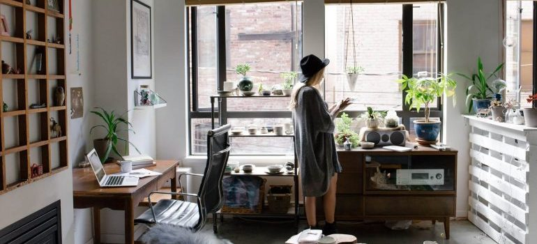 A girl standing in her apartment