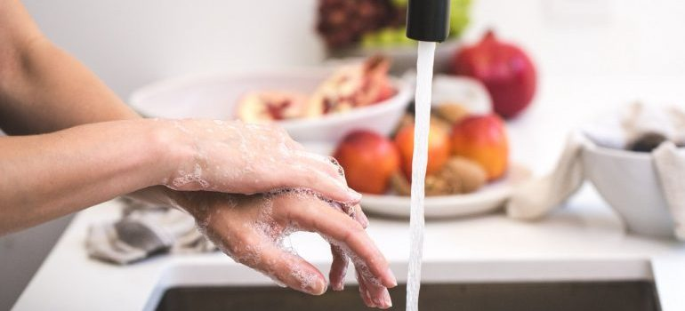 Woman washing her hands when moving the business during global pandemic