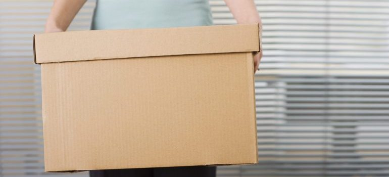 a person holding a moving box