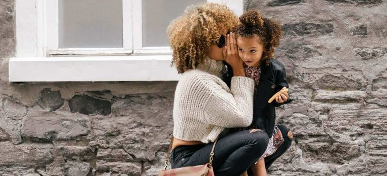 Mom and daughter whispering