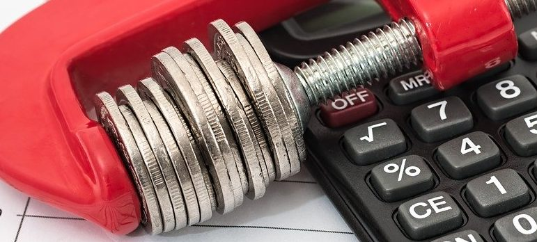 coins representing savings you can have when moving during peak season