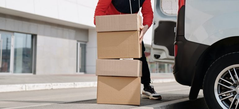 Man next to stacked moving boxes