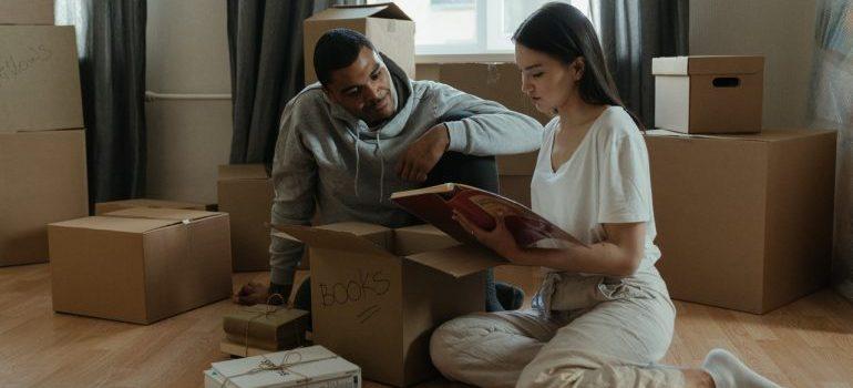 Woman and man unpacking.