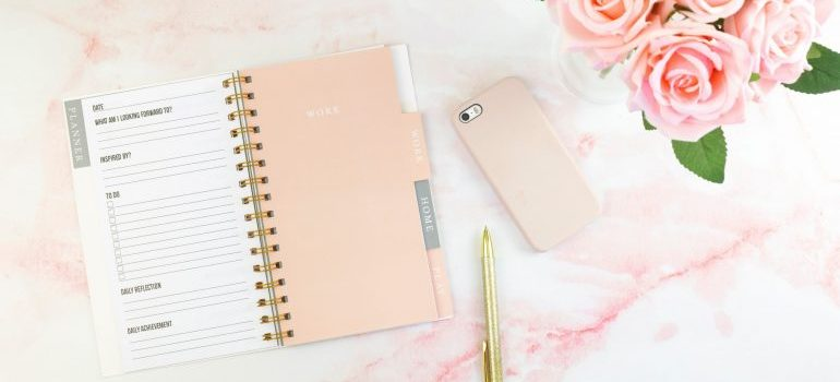 planner phone and a pen