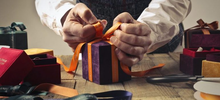 person packing a gift