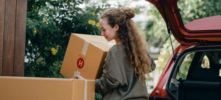 woman-carrying-cardboard-box