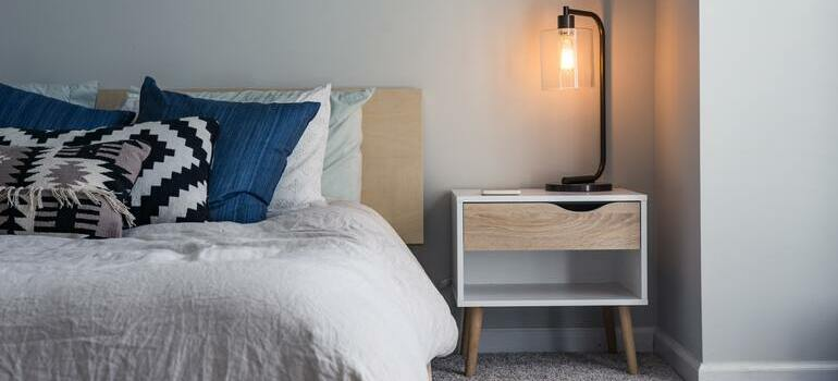 prepare your LA home for overnight guests by putting white sheet on the bed