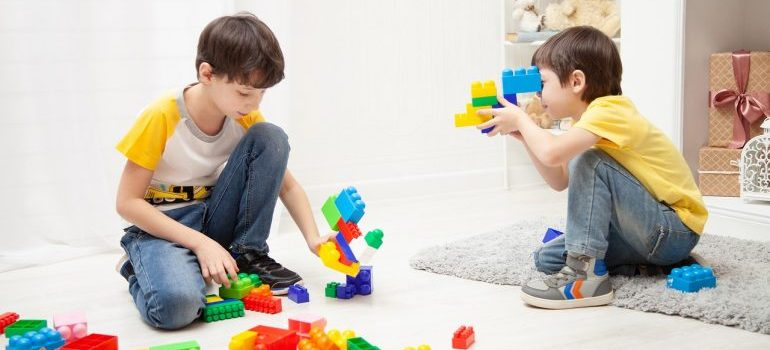 Two boys playing with toys