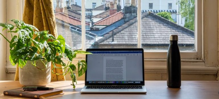 computer in front of the big window