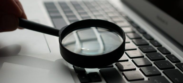 A magnifying glass on a keybord
