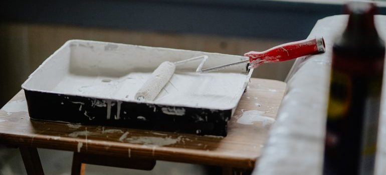 A painting brush in white paint