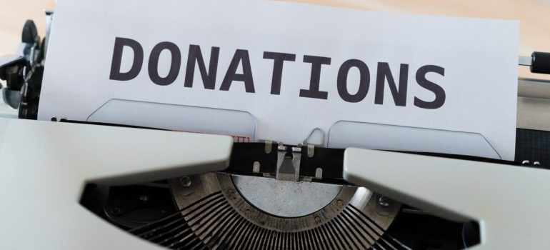 """""""donations"""" on old typing machine"""