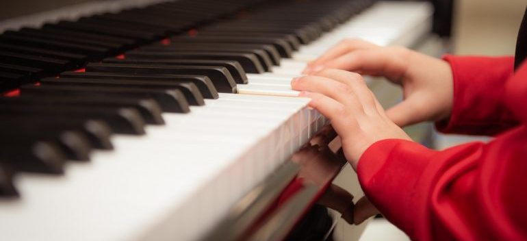 kid playing a piano