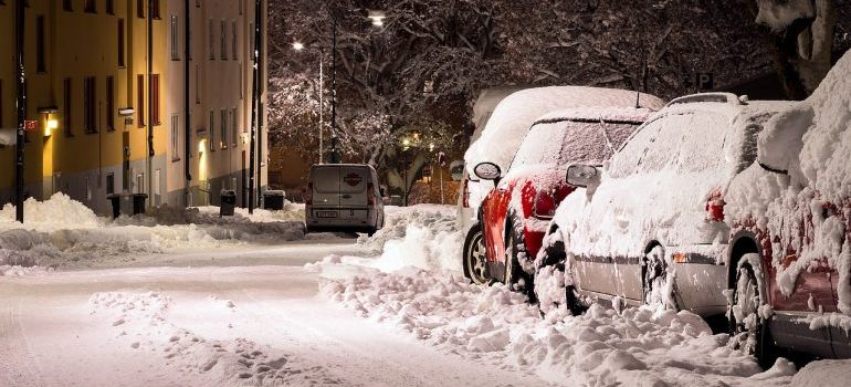 Cars parked on a snowy street