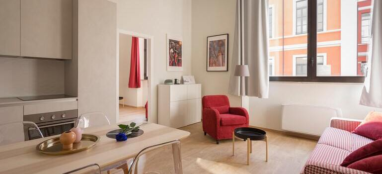 living in smaller spaces in Denver with red sofa