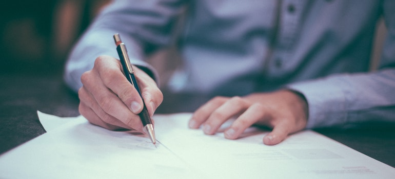 a man signing insurance documents