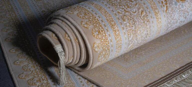 roll your carpet when moving rugs and carpets in Seattle