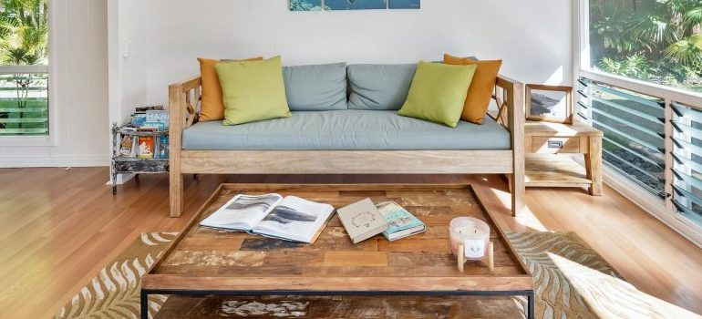 very bright living room, sofa and a table in the middle