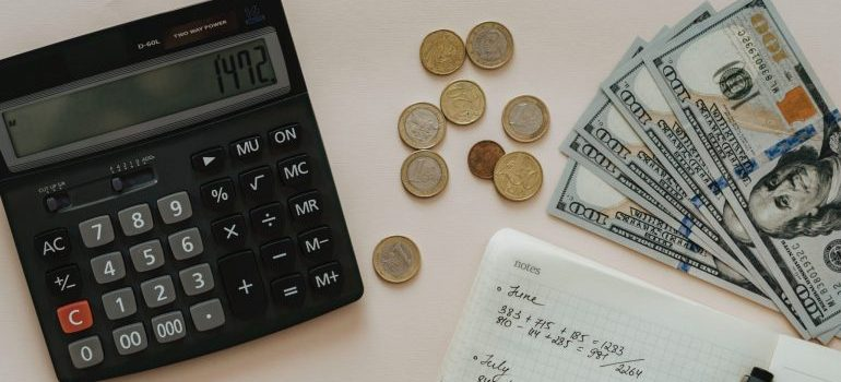 money and calculator on the table