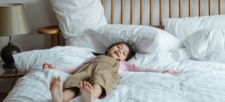 A child is lying on the bed