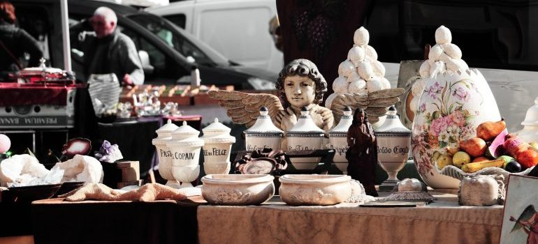 Various objects on a table during a yard sale