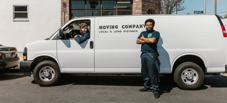 A guy in front of the white moving van