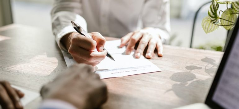 a person waiting to sign a contract in an office