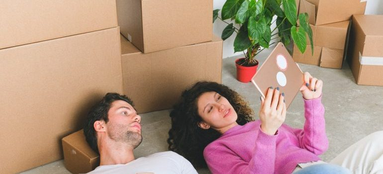 Couple planning what to do with packing materials