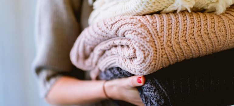 girl decluttering clothes