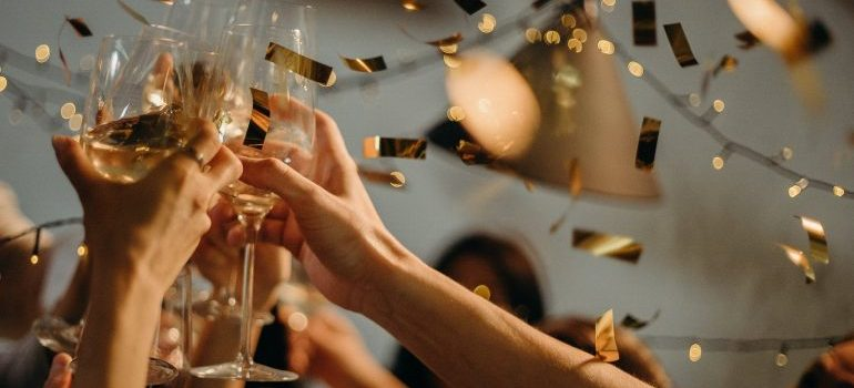 People toasting with wine glass as a way to celebrate a new beginning in LA