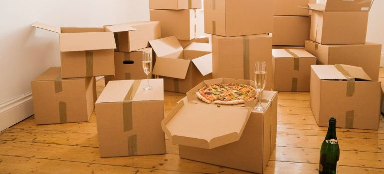 pizza and champagne on cardboard boxes are a good way to show appreciation to your helpers