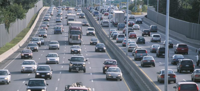 Cars stuck in a traffic jam during rush hours can make the relocation process exhausting