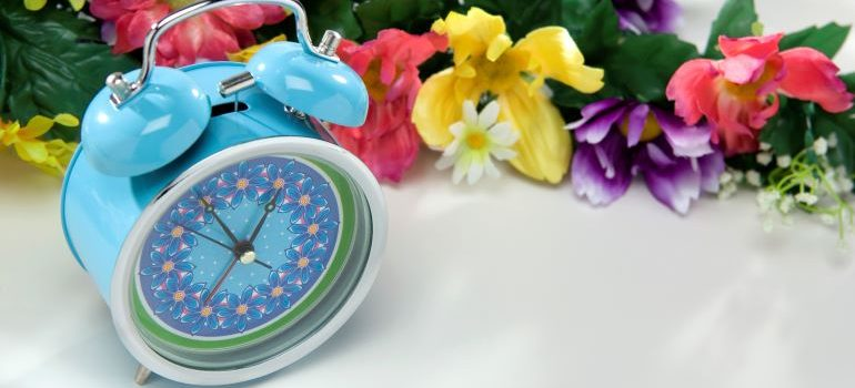 blue floral alarm-clock is number one on your moving checklist so you get an early start