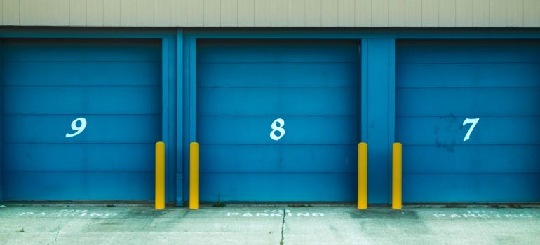 three blue-dyed storage doors with numbers on them